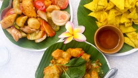 Thai Food in Thailand ,Picture of Delicious Thai Entree. Delicious and colorful Thai Entree. Thai food on banana leaf plates. Vegetables, salsa dips, traditional stock photos