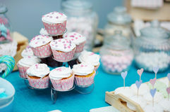 Delicious colorful wedding cupcakes stock photography