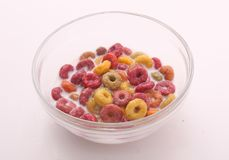 Delicious coloured Cereal with Milk. In bowl on white background Royalty Free Stock Photo