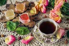Delicious ,colourful retro dessert of marmalade and a Cup of rose hip tea stock photography