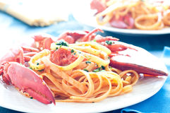 Delicious cooked Italian pasta with a sauce of lobster Royalty Free Stock Photography