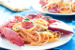 Delicious cooked Italian pasta with a sauce of lobster Stock Photo