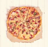 Delicious cooked pizza top view stock images