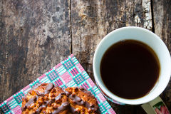 Delicious cookies with chocolate and nuts on a napkin next to a mug of strong tea Royalty Free Stock Photos