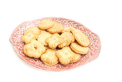 Delicious cookies on a dish. Delicious cookies on a plate on white background Stock Photo