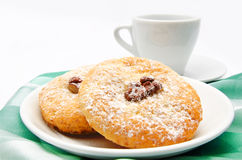 Delicious cookies on a plate and cup of tea isolated Royalty Free Stock Photos