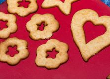 Delicious cookies on red table. Stock Images