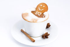 Delicious cookies taking a bath. Delicious cookies in the shape of a man taking a bath in a cappuccino in a white cup Stock Photos