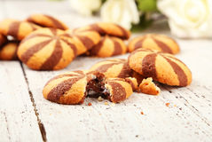 Delicious cookies on white wooden background. stock photos