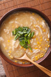 Delicious corn and chicken soup close up in a bowl. vertical top Royalty Free Stock Photo