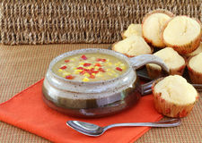 Delicious corn chowder and corn muffins. Stock Photography