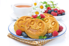 Delicious corn pancake with berries, tea and honey for breakfast Royalty Free Stock Photography