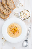 Delicious corn soup and bread, top view, vertical Stock Photos