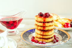 Delicious cottage cheese pancakes with cherry jam and cranberrie Stock Photos