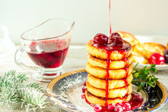 Delicious cottage cheese pancakes with cherry jam and cranberrie Stock Image