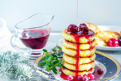 Delicious cottage cheese pancakes with cherry jam and cranberrie Stock Photo