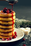 Delicious cottage cheese pancakes with cherry jam and cranberrie Royalty Free Stock Photo