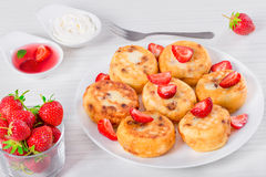 Delicious Cottage cheese pancakes with raisins and strawberries Royalty Free Stock Photography