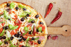 Delicious country style pizza. Royalty Free Stock Photography