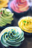 Delicious cream color cupcakes in a bakery shop Stock Photo