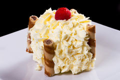 Delicious cream dessert. Delicious cream cake dessert on the plate Royalty Free Stock Photos