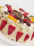 Delicious cream layer cake with strawberries Stock Photo