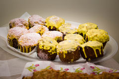 Delicious cream muffins on a plate. Indoor Royalty Free Stock Photography