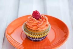 Delicious cream and raspberry cupcake Stock Photography