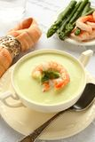 Delicious cream soup with asparagus and shrimp Stock Photo