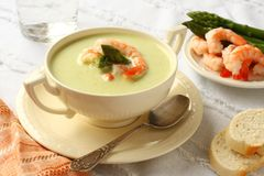 Delicious cream soup with asparagus and shrimp Royalty Free Stock Photos