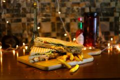 Chicken Club sandwich with French Fries. Delicious Creamy Chicken Club sandwich with French Fries stock photos