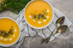 Delicious creamy homemade pumpkin soup with cream and pumpkin se. Ed garnish Stock Photo