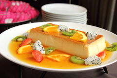 Delicious creme caramel dessert with fruit Stock Image