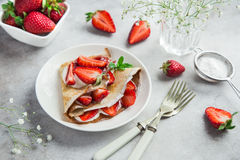 Delicious crepe with cream cheese and fresh strawberry on white Royalty Free Stock Photo