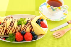 Delicious crepe. With fruits on the plate stock image