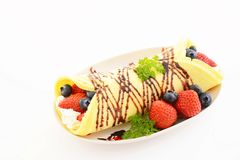 Delicious crepe. With fruits on the plate stock images