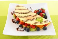 Delicious crepe. On the dining table royalty free stock photo