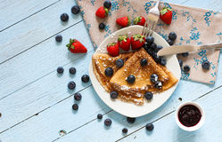 Delicious Crepes Breakfast with Dramatic light over a wood background. Delicious Crepes Breakfast with Dramatic light over a vintage wood background. An healthy Stock Photography