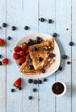 Delicious Crepes Breakfast with Dramatic light over a wood background Stock Images