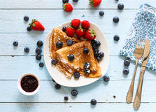 Delicious Crepes Breakfast with Dramatic light over a wood background. Delicious Crepes Breakfast with Dramatic light over a vintage wood background. An healthy Stock Images