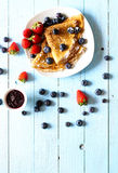 Delicious Crepes Breakfast with Dramatic light over a wood background. Delicious Crepes Breakfast with Dramatic light over a vintage wood background. An healthy Royalty Free Stock Photo