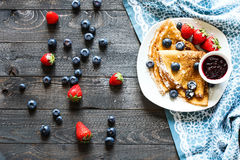 Delicious Crepes Breakfast with Dramatic light over a wood background Royalty Free Stock Image