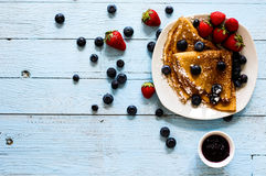 Delicious Crepes Breakfast with Dramatic light over a wood background. Delicious Crepes Breakfast with Dramatic light over a vintage wood background. An healthy Stock Photo