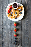 Delicious Crepes Breakfast with Dramatic light over a wood background Royalty Free Stock Images
