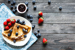 Delicious Crepes Breakfast with Dramatic light over a wood background Stock Photo