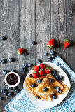 Delicious Crepes Breakfast with Dramatic light over a wood background. Delicious Crepes Breakfast with Dramatic light over a vintage wood background. An healthy Royalty Free Stock Image