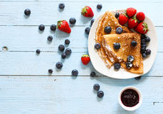 Free Delicious Crepes Breakfast With Dramatic Light Over A Wood Background Royalty Free Stock Image - 75618306