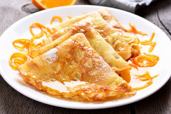 Delicious crepes with orange syrup Stock Photos