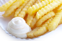 Delicious crinkly french fries with mayo Royalty Free Stock Photography