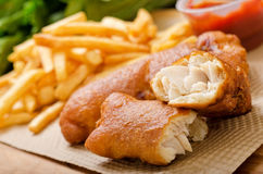 Fish and Chips. A delicious crispy battered deep fried fish and chips with greens and ketchup Stock Photo